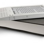 Image of a book and an Amazon Kindle reader.